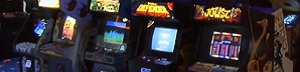 picture of 4 coin-operated video arcade games